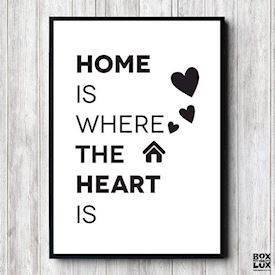 plakat med teksten home is where the heart is